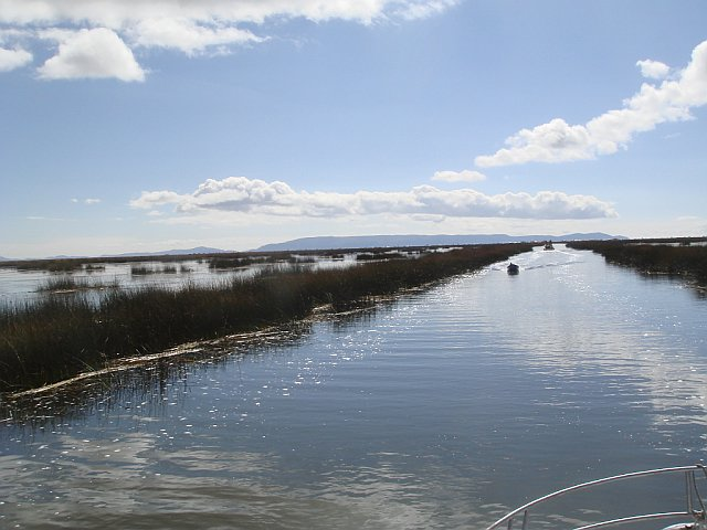 Taking a boat out to the floating islands, Lake Titicaca, Peru